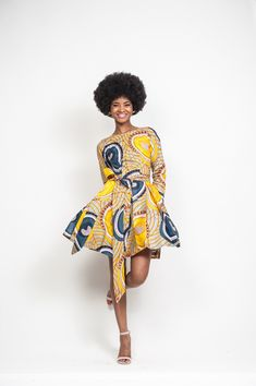 """Kavala wrap dress by Onyii & Co €227 Allover batik print · Long sleeves · Boxed pleats · Bodice lined · Exposed back · 100% Cotton · Dry clean · Made in USA · Model shown is 5'7"""" wearing US size 4-6 (small)."""