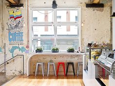 Shaky Isles Coffee Co. | Auckland (love the distressed walls, the tolix stools, and definitely the mural!)