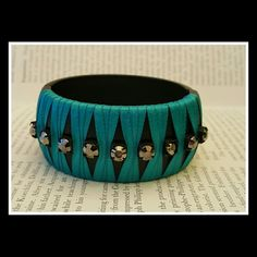 "Turquoise RHINESTONE BRACELET VERA WANG COLLECTION  Cool and UNIQUE Rhinestone matte black&turquoise bracelet Stretch Matte black ceramic bracelet with bright satin rich turquoise wrapped ribbon and gunmetal rhinestone details!   Width -  1 1/4"" Fits up to 8"" wrist  Never worn Vera Wang Jewelry Bracelets"
