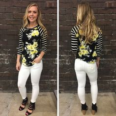 Our baseball tees always seem to fly out of the store! We love this black and white striped sleeve top with yellow floral! - $30 #springfashion #spring  #fashionista #shoplocal #aldm #apricotlaneboutique #apricotlanedesmoines #shopaldm #desmoines #valleywestmall #fashion #apricotlane #newarrival  #shopalb  #ootd #westdesmoines  #shopapricotlaneboutiquedesmoines #ontrend #baseballtee #stripes #floral