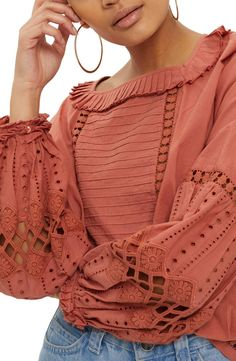 This might work because the sleeves aren't too full. Love the color and delicate but simple details. Monochromatic works