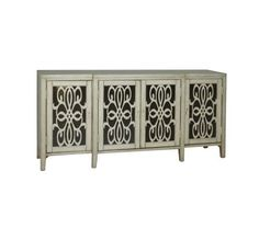 Elegant and modern, this silvery-toned accent credenza four doors with intricate art noveau inspired wood grilles over black glass panels. Jewelry inspired drop hardware is finished in polished nickel.