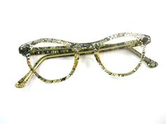 SALE glitter and netting plastic cat eye glasses. gold. very unique. atomic mad men style. NOS/deadstock new old stock with defects.