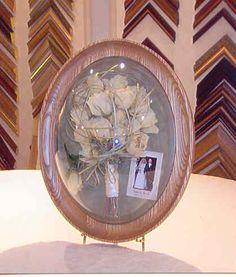 A dried wedding flower shadow box