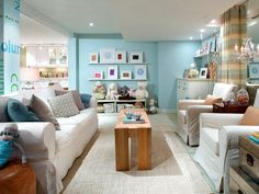Amazing Family Room Ideas: Amazing Family Room Ideas With White Sofa And Colorful Pillows And Blue Living Room Walls Design