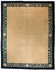 A Chinese carpet BB3225 - A Chinese rug, the oatmeal field with a subtle key-pattern and lotus vinery design overall ...