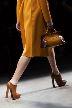 Bottega Veneta handbag from AW 2013 collection via The Sartorialist. ADORE the mustard + brown ombre, texture and proportions.  It doesn't hurt to be paired with a FABULOUS coat and classy heeled brogues.