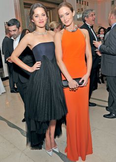 Actresses Marion Cotillard and Emily Blunt donned Halloween colors as they attended the Harper's Bazaar Woman of the Year Awards at Claridge's hotel in London, England on Oct. 31.