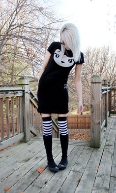 My clothing choices today, older Tokidoki shirt, stripes, and converse boots. #ootd #clothing #tokidoki #outfit #fashion