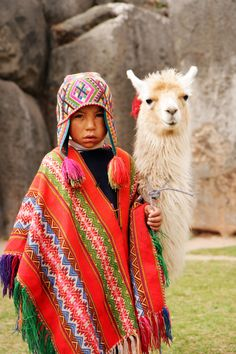 peruvian boy in traditional dress with lama at ancient ruins in cusco peru. Cusco Peru, Machu Picchu, Precious Children, Beautiful Children, Arte Latina, Argentine, Inca, Ancient Ruins, Baby Kind