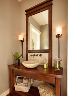 A stylish wooden vanity combined with the atmospheric lighting creates a nice, relaxed feel for the powder room.
