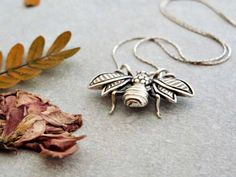 Sterling Silver Bee Charm Necklace. This timeless Bee charm is hand finished with exquisite detailing on the body and wings makes ita fail-safe gift for a loved one. by NikaNora on Etsy