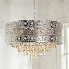 Lighting is an artful endeavor, especially in the case of our bejeweled chandelier. Influenced by modern bohemian styling, our gleaming, metallic chandelier features a punched floral pattern and warm amber crystal beads and drops. Pendant Chandelier, Chandelier Lighting, Morrocan Chandelier, Crystal Chandeliers, Crystal Lights, Crystal Pendant Lighting, Chandelier Ideas, Floral Chandelier, Modern Chandelier