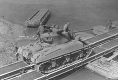 3rd AD M4A1 76w tanks crossing a pontoon bridge.