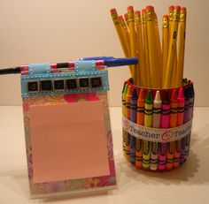 Teacher gift - can with crayons, hot glued with ribbon around. Plastic picture frame w/post it notes. Used ribbon to make a place for a pen and used scrapbook letters for the teachers name.