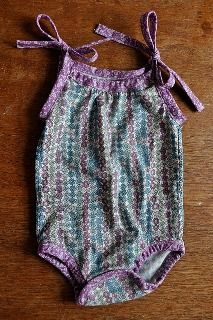 I love all baby clothes with the ribbon bow, or a cross back.