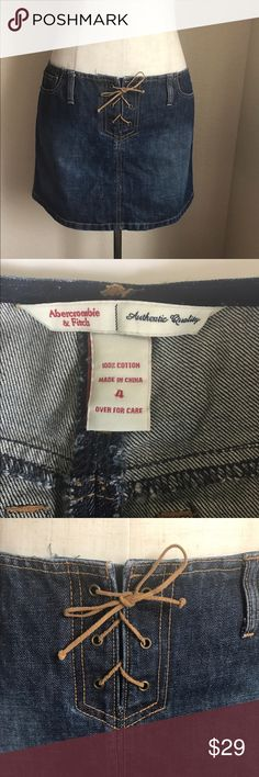 "Abercrombie & Fitch Blue Jean Mini Skirt Lace Up 4 Women's ABERCROMBIE & FITCH Blue Denim Mini Skirt Lace up closure with leather lace  100% Cotton, Signature Rivets & Logo Tab On Back Pocket  Size 4 Approximate Measurements (all measurements are approximate, taken in inches, lying flat) • Waist - 16"" laying flat & 32"" around  • Length - 13""  Like New Condition Abercrombie & Fitch Skirts Mini"