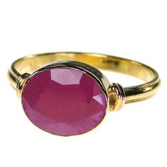 Materials 18k Gold and a Ruby. Specifics The stone is approx 3/8 inch wide.