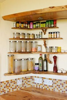 Love this spice shelf idea. Natural edge wood kitchen shelves at the Mud and Wood House - ww… Kitchen Wall Shelves, House Shelves, Kitchen Pantry Cabinets, Kitchen Storage, Door Spice Rack, Kitchen Spice Racks, Ikea Spice Rack, Spice Shelf, Rustic Country Kitchens