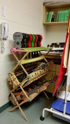 Homemade ukulele storage rack using a clothes drying rack, fabric, pool noodles, velcro, batting, foam