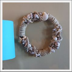 Sea Shell Rope Wreath.  A welcoming addition to your Beach Christmas theme. Clusters or natural sea shells and nautical rope wrap around the grape vine wreath.