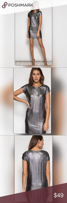 Silver Metallic Shift Mini Dress Be prepared for all eyes on you! This metallic shift dress gives just the right amount of sparkle to your evening. The short sleeve dress has a pleated pattern and a daring mini style. It is made of 60% cotton and 40% rayon. The NEW Boutique Dresses Mini