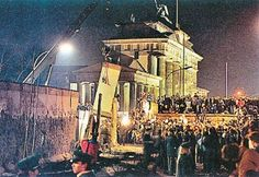 The Fall of the Berlin Wall, November 9, 1989    The East German government announces that visits in West Germany and West Berlin will be permitted. Thousands of East Berliners pass into West Berlin as border guards stand by. People begin tearing down the wall which is opened.