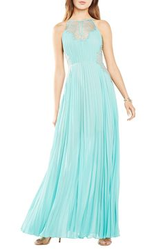 So in love with the aqua color of this BCBGMAXAZRIA pleated gown. The floral lace insets through the halter-style bodice add to the glam vibe.