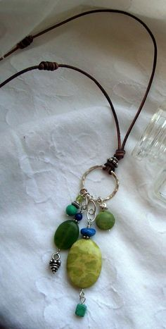 Gemstone charm on leather necklace by Sweet Nothings Jewelry - Would look great with Kazuri beads