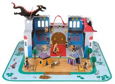 Fantastic Castle Puzzle Playset and thousands more of the very best toys at Fat Brain Toys. Piece together the landscape using the 16 jigsaw puzzle pieces and then open up the box to set up the powerfully vivid castle play scen. Chateau Medieval, Medieval Castle, Westerns, Enchanted Castle, Lego Knights, Gadgets, Château Fort, Wooden Figurines, Developmental Toys