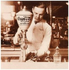 Coca-Cola dispenser, 1896. Long before bottles and cans, Coca-Cola came to American consumers as syrup mixed with soda and sold by the glass at drugstores and soda fountains.
