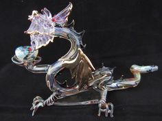 Hand blown glass scary face dragon pipe.
