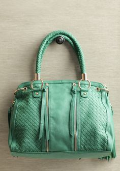 Garden Moss Tassel Purse 62.99 at shopruche.com. Add a touch of color to your outfit by carrying your essentials in this kelly green faux leather purse featuring classic woven detailing and decorative tassels. Finished with front decorative zippers and an optional, adjustable shoulder strap.3 outer zipper pockets,...