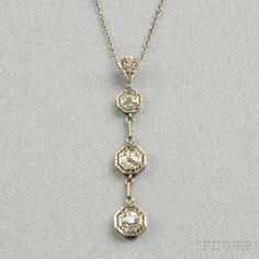 Art Deco Platinum and Diamond Pendant, set with old European- and old mine-cut diamonds, filigree mount, lg. 1 5/8 in., and suspended from t...