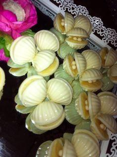 Doces lindos em formato de concha.