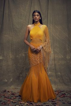 Mustard georgette lehenga saree with a collared blouse paired with a fishtail skirt and an attached dupatta with gold hand embroidery, gold glass beaded tassels and a buckle detail Saree Gown, Lehnga Dress, Dhoti Saree, Lehenga Saree, Anarkali, Sari, Indian Designer Outfits, Designer Dresses, Designer Sarees