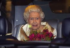 Fit for a Queen: The monarch was prized with a pair of stunning purple flowers ...