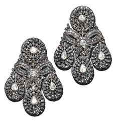 A PAIR OF DIAMOND GIRANDOLE EAR-PENDANTS   Each set with three pear-shaped rose-cut diamond drops to the ribbon bow surmount suspended by a cluster top, circa 1760