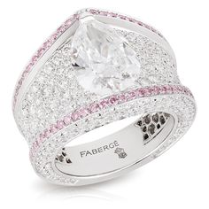 This piece is set in 18 carat white gold and features 364 white and pink diamonds totalling 3.74 carats. The centre stone is a pear-shaped D VS2 white diamond of 3.02 carats. (Fabergé) ... Gorgeous <3
