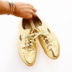 "Such a cool pair of vintage 80s/90s L.A gear Lame gold tennis shoes. Very comfortable.  Measurements:  S I Z E : 7 US ( runs narrow, so better for a size 6 1/2 or a 7 with narrow feet)  I N S O L E : 9 1/2""  W I D T H : 2 1/2""  M A T E R I A L : man-made  S H I P P I N G: $10 (Within US), $18 (international)   **Front of the left shoe has a tiny rip, otherwise in excellent condition** _______________________________________________  Stay in contact :  + instagram..."