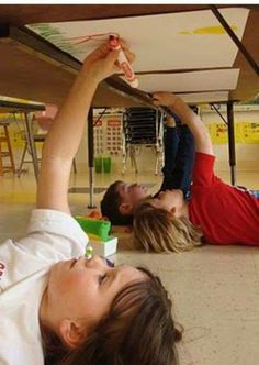 Under the table art/writing... Upper body strength and keeping them entertained with something new