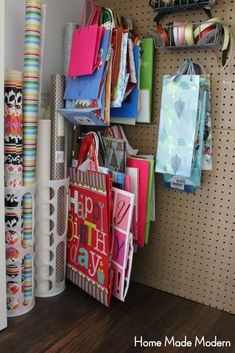 Real Life Storage Hacks - Home Made Modern Organizing wrapping paper and gift bags. Real Life Storage Hacks - Home Made Modern Organizing wrapping paper and gift bags. Gift Bag Organization, Gift Bag Storage, Wrapping Paper Organization, Craft Paper Storage, Organizing Gift Bags, Wrapping Paper Station, Organizing Life, Storage Hacks, Diy Storage