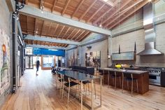 San Francisco Loft by Wardell Sagan Projekt. Converted a former 3200 square foot (300 square meters) former Chinese Laundry and Tooth Powder Factory into a modern open loft with roof deck and two internally placed shipping containers to showcase an urban art collection