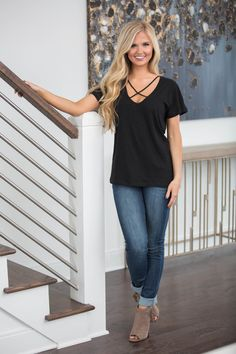 This bold blouse is perfect for changing spring days! We love the dramatic v-neckline with criss-crossing straps - it's such a unique look! The beautiful black color is just a year-round essential - i