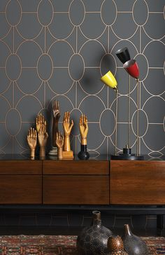 Offering a softer and more graceful take on the geometry and linear styles of the Art Deco period. Riviera features gently curved interlocking ovals printed in a softly raised textured finish, Riviera comes in four classic neutral colourings of black and white, graphite on grey, charcoal on sand and metallic bronze on charcoal.
