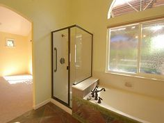 Bathroom with tub and stand-up shower with a window!