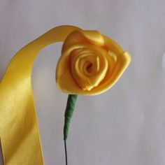 How to make an easy bridal bouquet ribbon rose via @Guidecentral - Visit www.guidecentr.al for more #DIY #tutorials