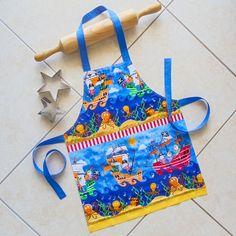 Kids Apron blue, pirate pattern theme, childs kitchen craft art play apron, boys girls lined cotton apron with yellow border, Cheeky Pirates