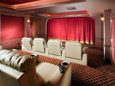 Amazing Home Theater Designs A traditional red velvet curtain gives this beautiful space an old Hollywood feel. The patterned carpet, columns and wood detailing also contribute to the classic look of the space. Copyright CEDIA Used with permission. Home Theater Setup, Best Home Theater, At Home Movie Theater, Home Theater Speakers, Home Theater Rooms, Home Theater Seating, Home Theater Projectors, Home Theater Design, Cinema Room