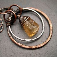 Artisan-made brass and sterling silver circle necklace with citrine nugget drop